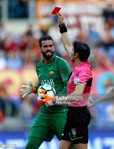The referee Gianpaolo Calvarese shows the red card to Juan Jesus of AS Roma as Alisson Becker reacts during the serie A match between AS Roma and AC...