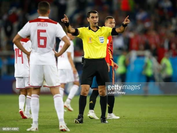 The referee gives a VAR decision for Lago Aspas of Spain's goal for their second to make it 22 during the 2018 FIFA World Cup Russia group B match...