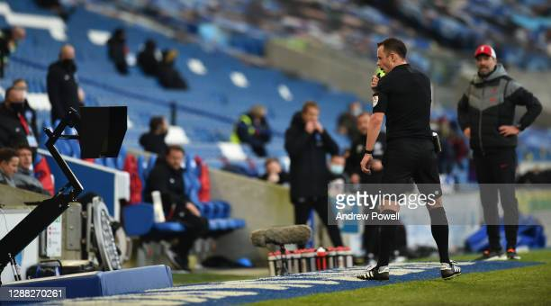 The Referee Goes to the VAR Monitor and changes his mind Goal disaloud during the Premier League match between Brighton & Hove Albion and Liverpool...