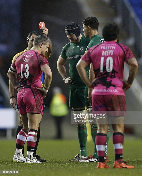 The Referee Greg Garner shows a red card to Tom May of London Welsh as Daniel Leo pf London Irish looks on during the Aviva Premiership match between...