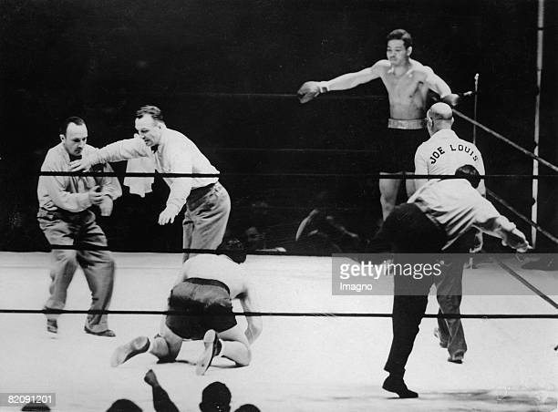 The referee is counting the seconds at the heavy weight boxing match for the title of the world champion between Joe Louis and Max Schmeling New York...