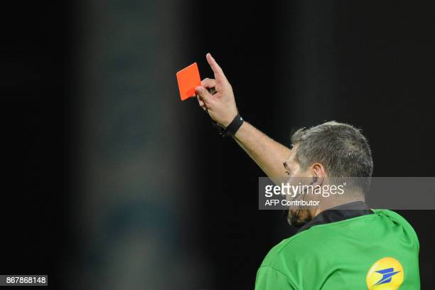 The referee Jerome Garces gives a red card to La Rochelle's French lock William Demotte during the French Top 14 rugby union match between La...
