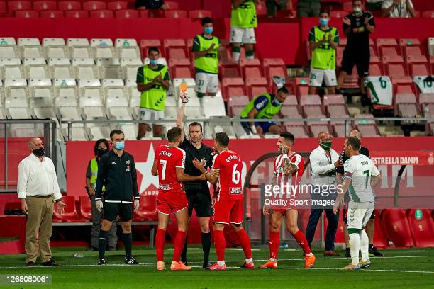 The referee Jose Antonio Lopez Teca shows a red card to Christian Stuani of Girona FC during the La Liga Smartbank Playoffs match between Girona and...