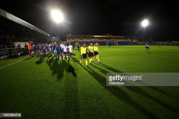 The Referee leads the teams out prior to the UEFA Women's Champions League Round of 16 1st Leg match between Chelsea Women and Fiorentina Women at...