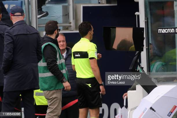 The referee looks at the var during the Serie A match between Cagliari and SPAL at Sardegna Arena on April 7 2019 in Cagliari Italy