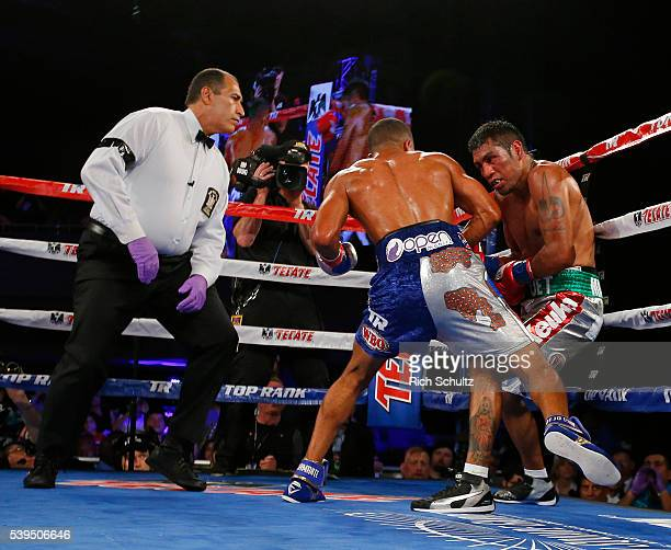 The referee looks on as Felix Verdjo punches Juan Jose Martinez against the ropes in the fifth round of their Lightweight bout on June 11 2016 at the...