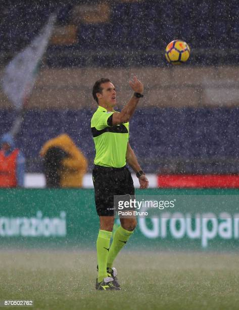 The referee Luca Banti and Larangeira Danilo of Udinese Calcio and Senad Lulic of SS lazio check the field condition before the Serie A match between...