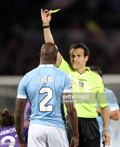 The Referee Luca Banti shows the yellow card to Michael Ciani of SS Lazio during the Serie A match between ACF Fiorentina and SS Lazio at Stadio...
