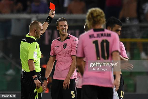 The referee Luca Pairetto shows a red card to Slobodan Rajkovic of Palermo during the Serie A match between US Citta di Palermo and US Sassuolo at...
