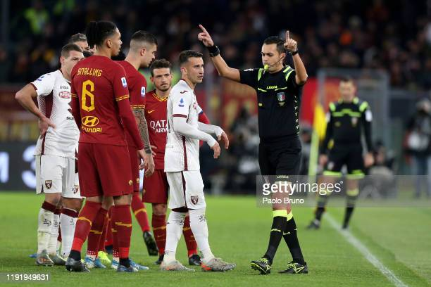 The referee Marco Di Bello gestures during the Serie A match between AS Roma and Torino FC at Stadio Olimpico on January 5 2020 in Rome Italy