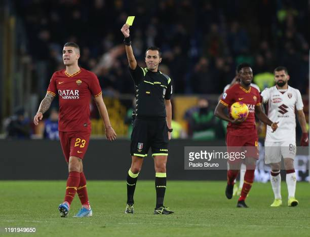 The referee Marco Di Bello shows the yellow card to Gianluca Mancini of AS Roma during the Serie A match between AS Roma and Torino FC at Stadio...