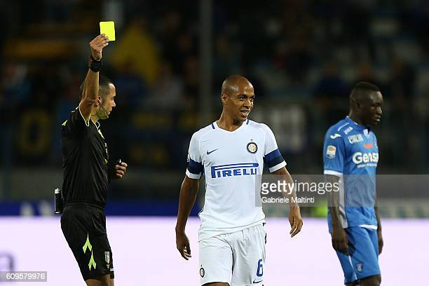 The referee Marco Guida shows a yellow card to Joao Mario of FC Internazionale during the Serie A match between Empoli FC and FC Internazionale at...