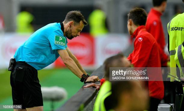 The referee Markus Schmidt uses the Video Assistant Refereeing during the German first division Bundesliga football match Fortuna Duesseldorf v FC...
