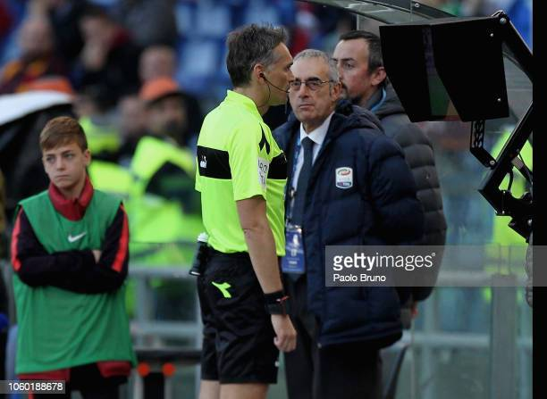 The referee Massimiliano Errati checks the VAR during the Serie A match between AS Roma and UC Sampdoria at Stadio Olimpico on November 11 2018 in...