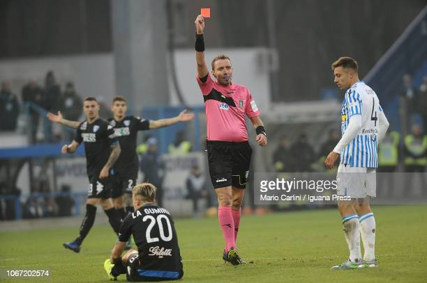 the referee Mazzoleni shows a red card to Thiago Cionek of SPAL during the Serie A match between SPAL and Empoli at Stadio Paolo Mazza on December 1...