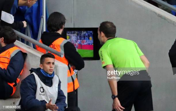 the referee Melero Lopez watching the VAR during the match between RCD Espanyol and Club Atletico Osasuna corresponding to the week 15 of the Liga...