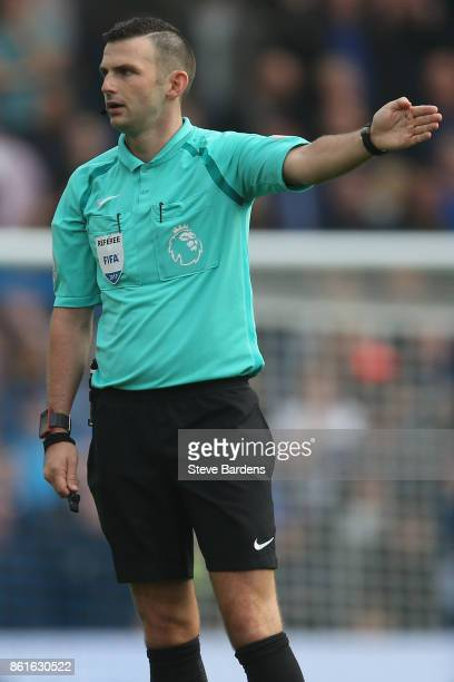 The Referee Michael Oliver gives a decision during the Premier League match between Brighton and Hove Albion and Everton at Amex Stadium on October...