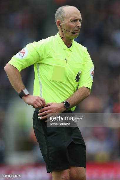 The Referee Mike Dean during the Premier League match between Brighton Hove Albion and Huddersfield Town at American Express Community Stadium on...