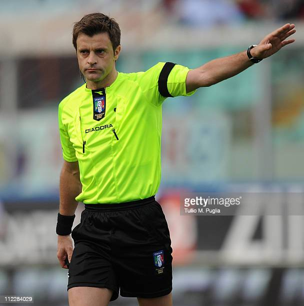 The referee Nicola Rizzoli gestures during the Serie A match between Catania Calcio and SS Lazio at Stadio Angelo Massimino on April 17 2011 in...