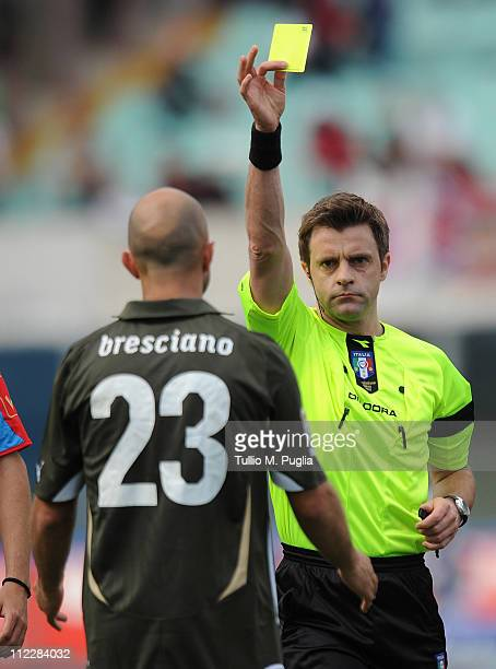The referee Nicola Rizzoli gets a yallow card to Mark Bresciano of Lazio during the Serie A match between Catania Calcio and SS Lazio at Stadio...