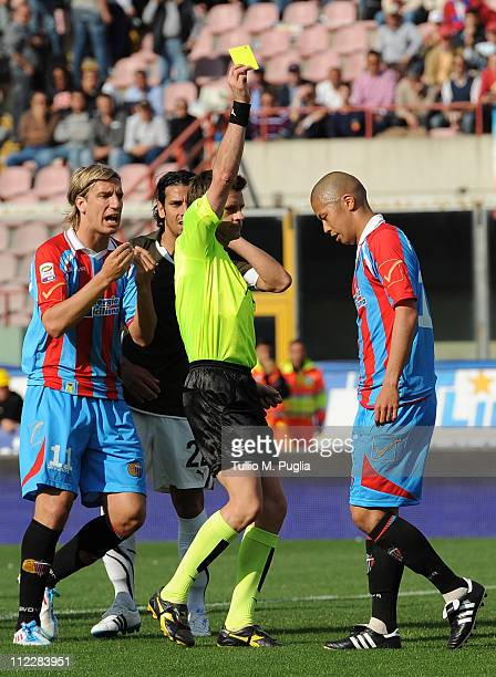 The referee Nicola Rizzoli gets a yallow card to Takayuki Morimoto of Catania during the Serie A match between Catania Calcio and SS Lazio at Stadio...