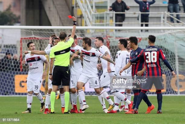 The referee Paolo Tagliavento shows the red card to Fabio Pisacane of Cagliari during the serie A match between FC Crotone and Cagliari Calcio at...