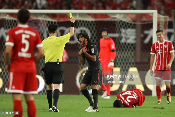 The referee produces a yellow card to Mohamed Elneny of Arsenal during the 2017 International Champions Cup football match between FC Bayern and...