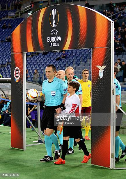 The referee Ruddy Buquet enters to the field during the UEFA Europa League Round of 16 second leg match between SS Lazio and Sparta Prague at Stadio...