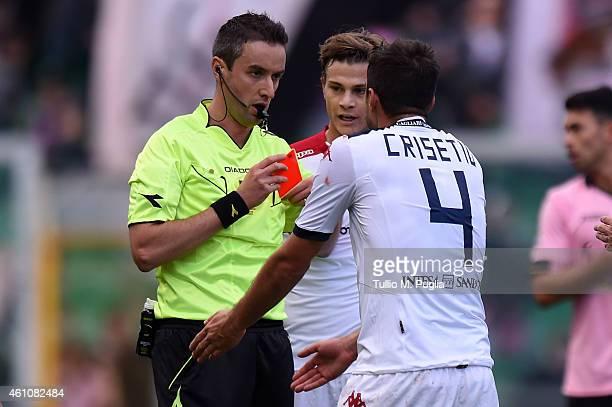 The referee Sebastiano Peruzzo gives a red card to Lorenzo Crisetig of Cagliari during the Serie A match between US Citta di Palermo and Cagliari...