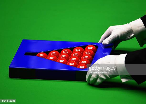 The Referee sets up the balls on day eleven of the World Championship Snooker at Crucible Theatre on April 26, 2016 in Sheffield, England.