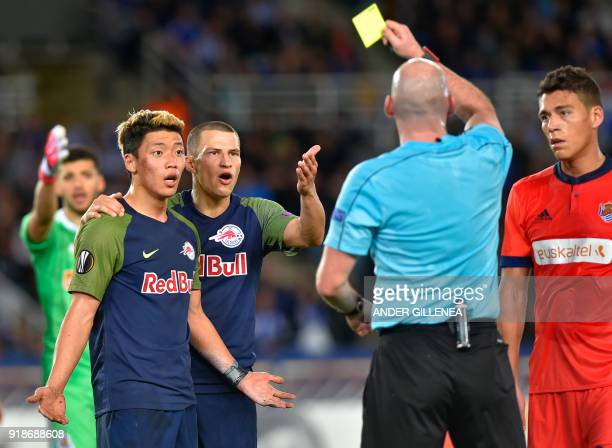 The referee shows a red card to FC Salzburg's South Korean forward Hwang HeeChan during the UEFA Europa League first leg round of 32 football match...