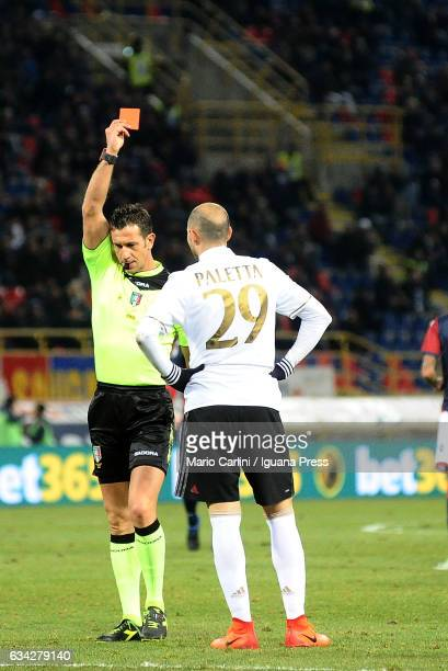 the referee shows a red card to Gabriel Paletta of AC Milan during the Serie A match between Bologna FC and AC Milan at Stadio Renato Dall'Ara on...