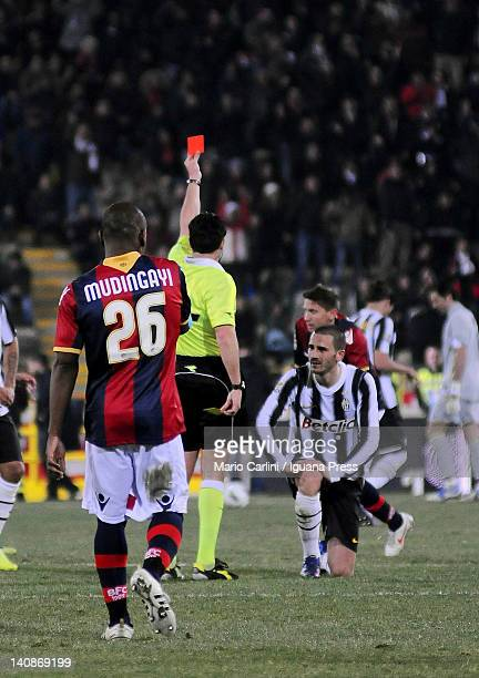 The referee shows a red card to Leonardo Bonucci of Juventus FC during the Serie A match between Bologna FC and Juventus FC at Stadio Renato Dall'Ara...