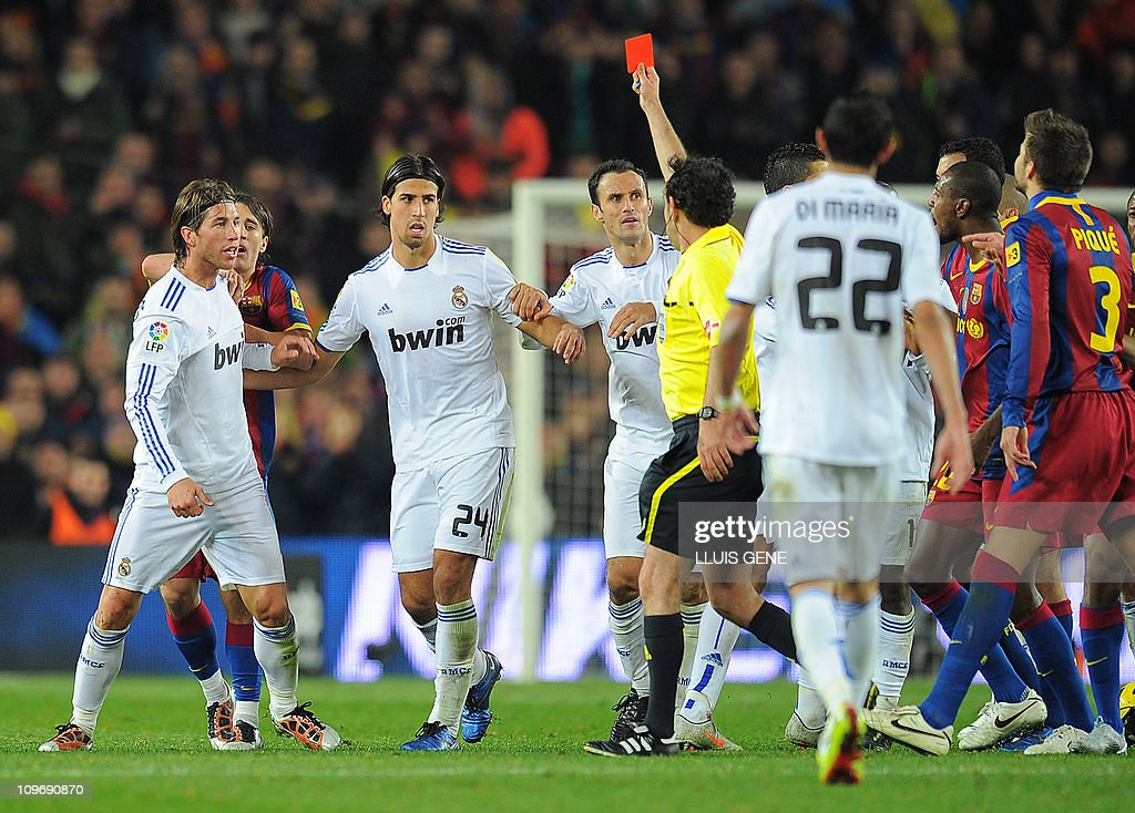 The referee shows a red card to Real Madrid's defender Sergio Ramos (2ndL) during the Spanish league 'clasico' football match FC Barcelona vs Real Madrid on November 29, 2010 at Camp Nou stadium in Barcelona. Barcelona won 5-0.