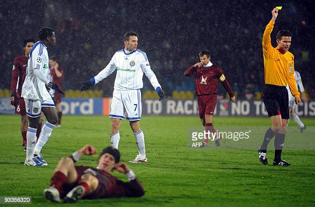 The referee shows a yellow card to Andriy Shevchenko of Ukraine's Dynamo Kiev during their UEFA Champions league football match against Russia's...
