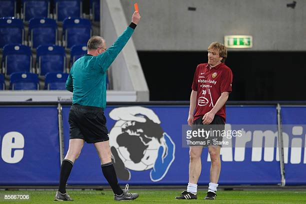 The referee shows the red card to Ansgar Brinkmann during the Ansgar Brinkmann Farewell Match at the Schueco Arena on March 27 2009 in Bielefeld...