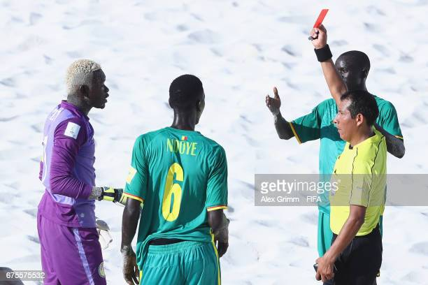 The referee shows the red card to goalkeeper Al Seyni Ndiaye of Senegal during the FIFA Beach Soccer World Cup Bahamas 2017 group A match between...