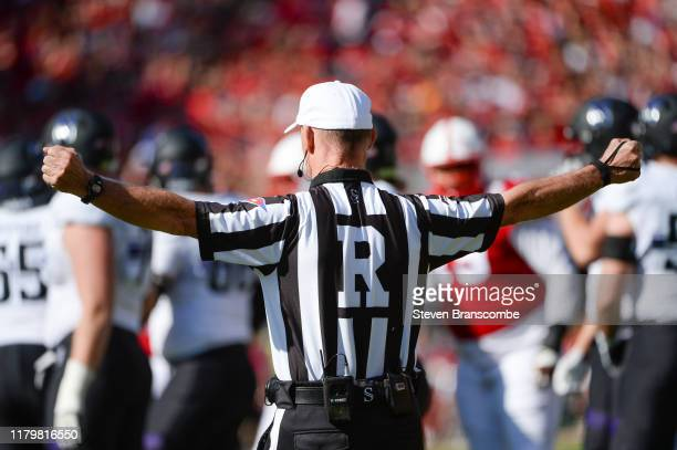 The referee signals during the game between the Nebraska Cornhuskers and the Northwestern Wildcats at Memorial Stadium on October 5 2019 in Lincoln...