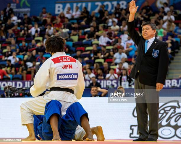 The referee signals ippon after Chizuru Arai of Japan held Marie Eve Gahie of France for 20 seconds to win the u70kg gold medal during day five of...