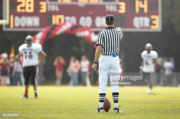 The referee signals the start of the second half of the high school football game between Sacred Heart Prep of Atherton, California, and Salesian...