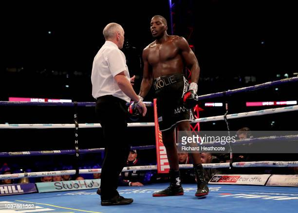 The referee speaks to Lawrence Okolie during the British Cruiserweight Championship title fight between Matty Askin and Lawrence Okolie at Wembley...