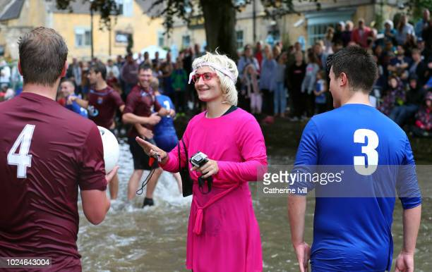 The referee speaks to the players from Bourton Rovers as they compete against each other during the annual BourtonontheWater Football Match played on...
