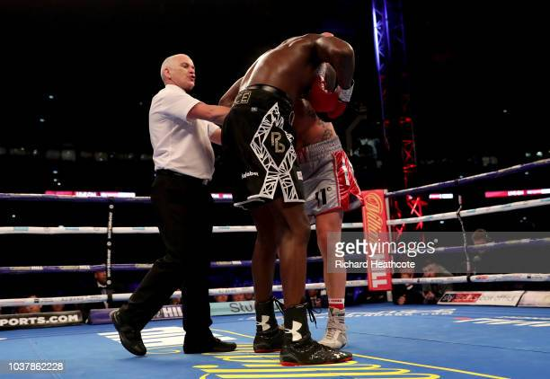 The referee splits up Lawrence Okolie and Matty Askin during the British Cruiserweight Championship title fight between Matty Askin and Lawrence...