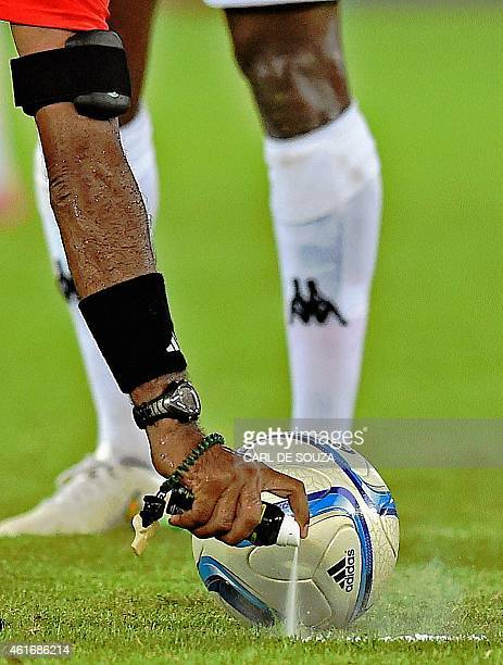 The referee sprays the line prior to a kick-off during the 2015 African Cup of Nations group A football match between Burkina Faso and Gabon at Bata...