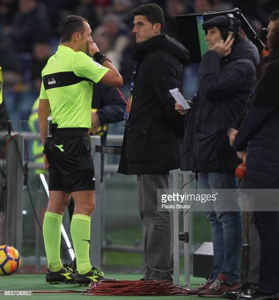 The referee Stefano Alassio checks the VAR during the Serie A match between AS Roma and Spal at Stadio Olimpico on December 1 2017 in Rome Italy