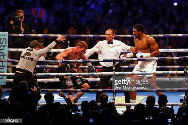 The referee steps in as Anthony Joshua knocks out Alexander Povetkin during the IBF WBA Super WBO IBO World Heavyweight Championship title fight...