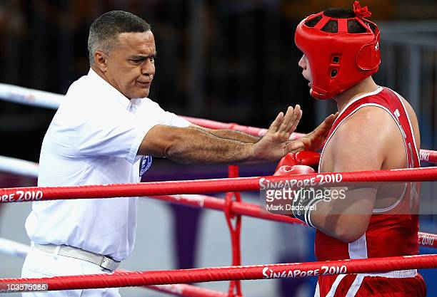 The referee stops Siyovush Zukhurov of Tajikistan in his fight against Umit Can Patir of Turkey in the Boxing Heavy 91kg bronze medal match on day 10...