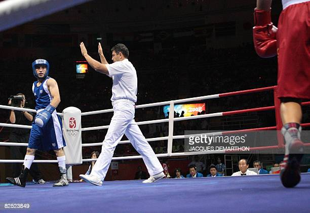 The referee stops the bout of Ukraine's Vasyl Lomachenko against France's Khedafi Djelkhir during the Beijing 2008 Olympic Games Featherweight final...