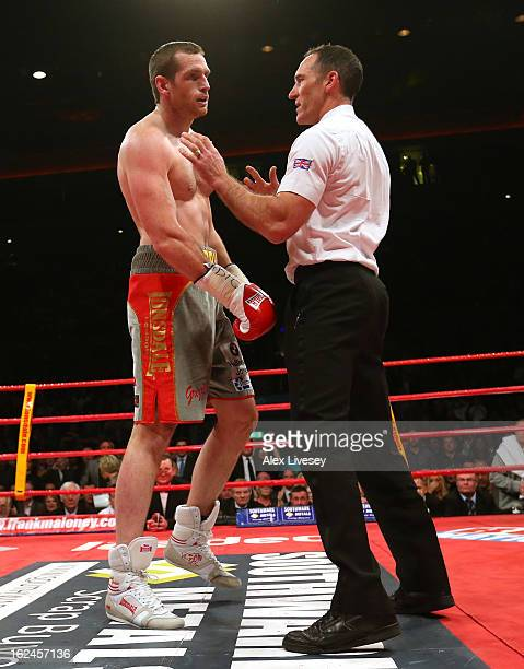 The referee stops the contest in round two as David Price of Great Britain struggles to his feet after he's knocked down by Tony Thompson of USA...