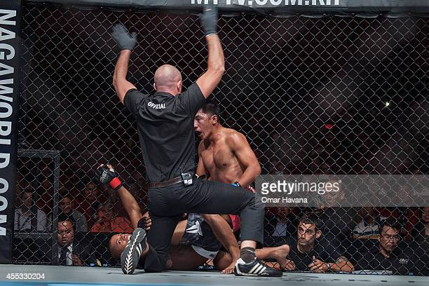 The referee stops the fight after Adriano Moraes knocksout Geje Eustaquio for the Flyweight World Championship during One FC Cambodia on September 12...
